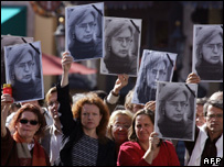 Demonstrators hold pictures of Anna Politkovskaya