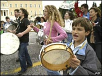 Protesters beat drums in front of the Greek Parliament in Athens