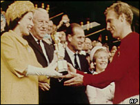 The Queen hands Bobby Moore the World Cup after England's victory