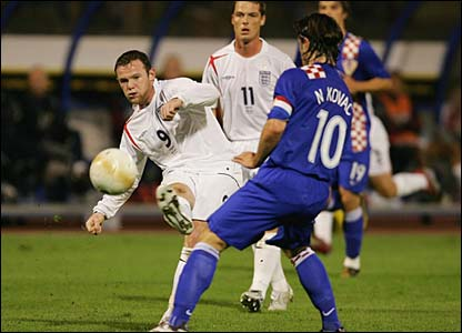 Wayne Rooney sees his shot blocked by Niko Kovac