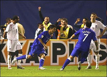 Eduardo da Silva reels away in celebration
