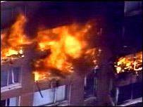 Building aflame after plane crash in New York