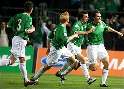 Kevin Kilbane is mobbed by his team-mates