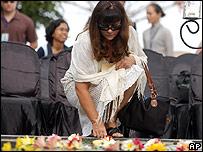 Australian mourner lays flowers at a memorial service at Jimbaran Hill, Bali