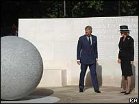 Prince Charles and the Duchess of Cornwall inspect the memorial