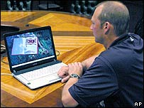 A man watching a film on a laptop