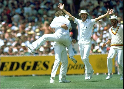 Ian Botham (back to camera) hugs Ian Gould as Chris Tavare and Geoff Miller look on