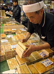 A man arranges packs of sea urchin from North Korea at a shop in Tokyo