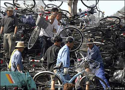Workers on a North Korean ship pack used bicycles at Japan's Maizuru port