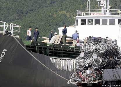 A North Korean ship packs a load of used bicycles and refrigerators at Japan's Maizuru port