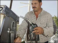 Man fills up his car at petrol station in Oklahoma City