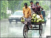 Farmers in Bangladesh cycling a rickshaw full of produce