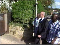 Officers from the Gambia and Sussex outside William West's house