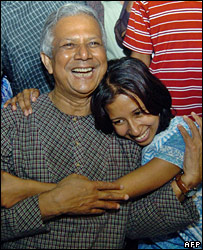 Muhammad Yunus, hugged by his daughter, Dina