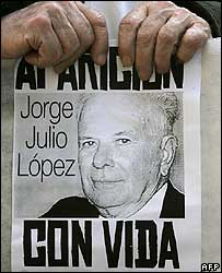 A banner with the portrait of Julio Lopez