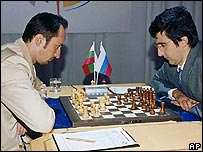 World Chess Champion Veselin Topalov, left, and Classical World Champion Vladimir Kramnik, right