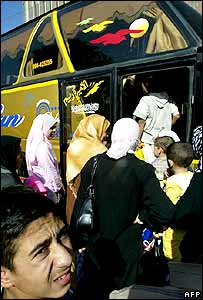 Iraqis getting on coach to leave Iraq