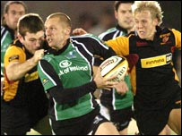 Connacht's Paul Warwick comes under pressure from the Dragons