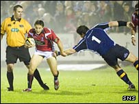 Chris Cusiter (left) is tackled by Leinster prop Reggie Corrigan