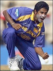 Chaminda Vaas celebrates the wicket of Ramnaresh Sarwan