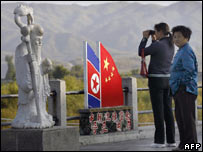 Chinese visitors at the border between China and North Korea