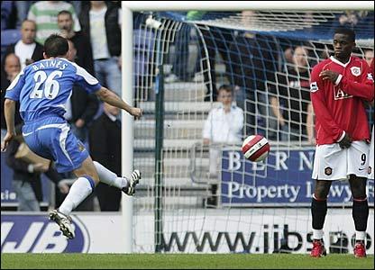 Leighton Baines blasts a free-kick past Edwin van der Sar