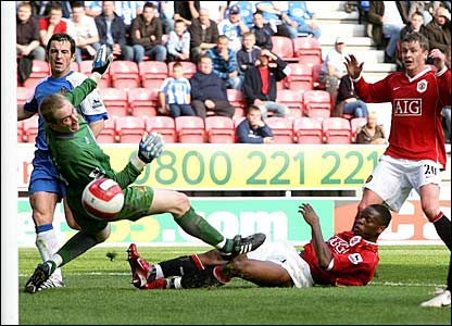 Louis Saha scores for Man Utd
