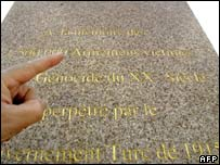 Someone points to the inscription on the Armenian memorial in Marseille