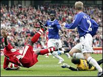 Yakubu is brought down by Everton keeper Tim Howard