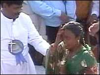 Woman being baptised in Nagpur