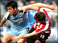 Manchester City's Joey Barton and Sheffield United's Michael Tonge tangle