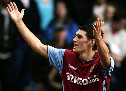 Gareth Barry raises his arms to the crowd