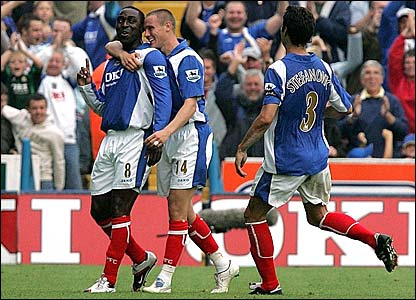 Andy Cole is congratulated by his team-mates