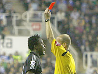 John Obi Mikel is sent off by referee Mike Riley