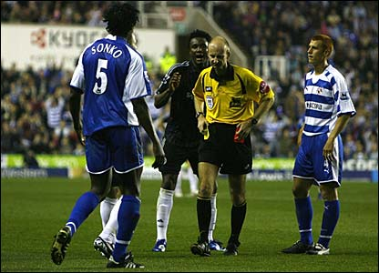 John Obi Mikel remonstrates with referee Mike Riley