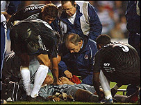 Carlo Cudicini lies prone on the ground