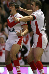 St Helens's Ade Gardner celebrates his try against Hull with Mike Bennett (right)