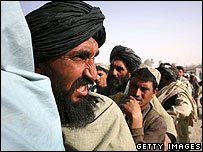 Afghans wait to cross Pakistani border at  Spin Boldak this summer