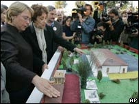 President Bachelet (left) and her mother look at a model replica of Villa Grimaldi