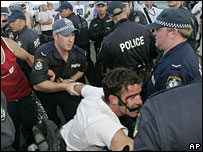 Police arrest a man on Cronulla beach on 11 December 2005