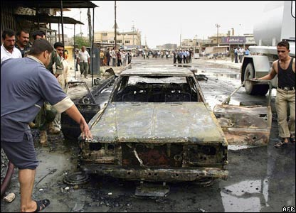 Car damaged in bombing in Kirkuk, 15 October 2006