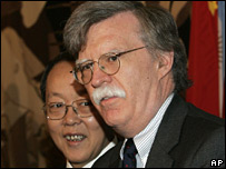 US envoy John Bolton, with Chinese envoy Wang Guangya behind him on 14 October 2006