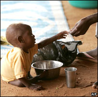 Sudanese child reaching out for food (Image: AP)