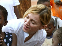 Madonna talks to children while visiting Malawi