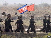 North Korean soldiers carry the flag near the Chinese border on 16 October 2006