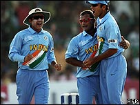 Indian cricketers celebrate a wicket