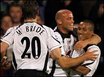 Fulham celebrate Claus Jensen's goal