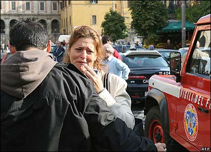 An injured woman cries after two metro trains crash in Rome
