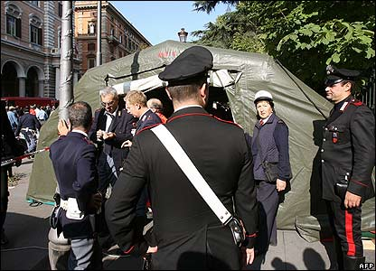 Italian military police stand next to a temporary hospital near Victor Emanuele II station