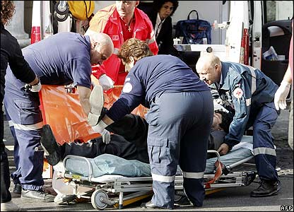Rescue workers attend to a survivor of the underground train crash in Rome